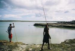 Boys spear fishing at Rrakala