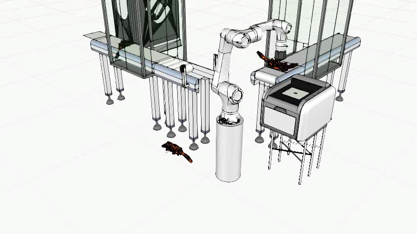 A simple part assembly is performed after transference of parts to another conveyor belt to begin second process.