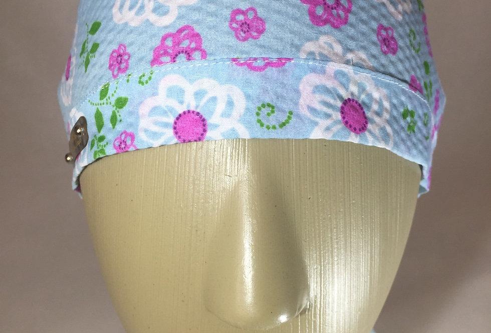 Gorro azul claro flores rosa