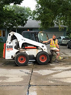 Chris with Bobcat Working.JPG