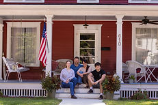 Christian with Family Front Porch.jpg