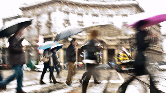 Inverno con ombrello, sciarpa o cappello?
