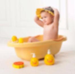 Baby bathing happily with Piyo Piyo Products