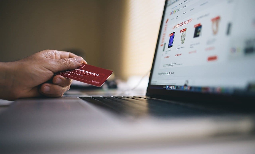 Paying online to ecommerce website on a laptop