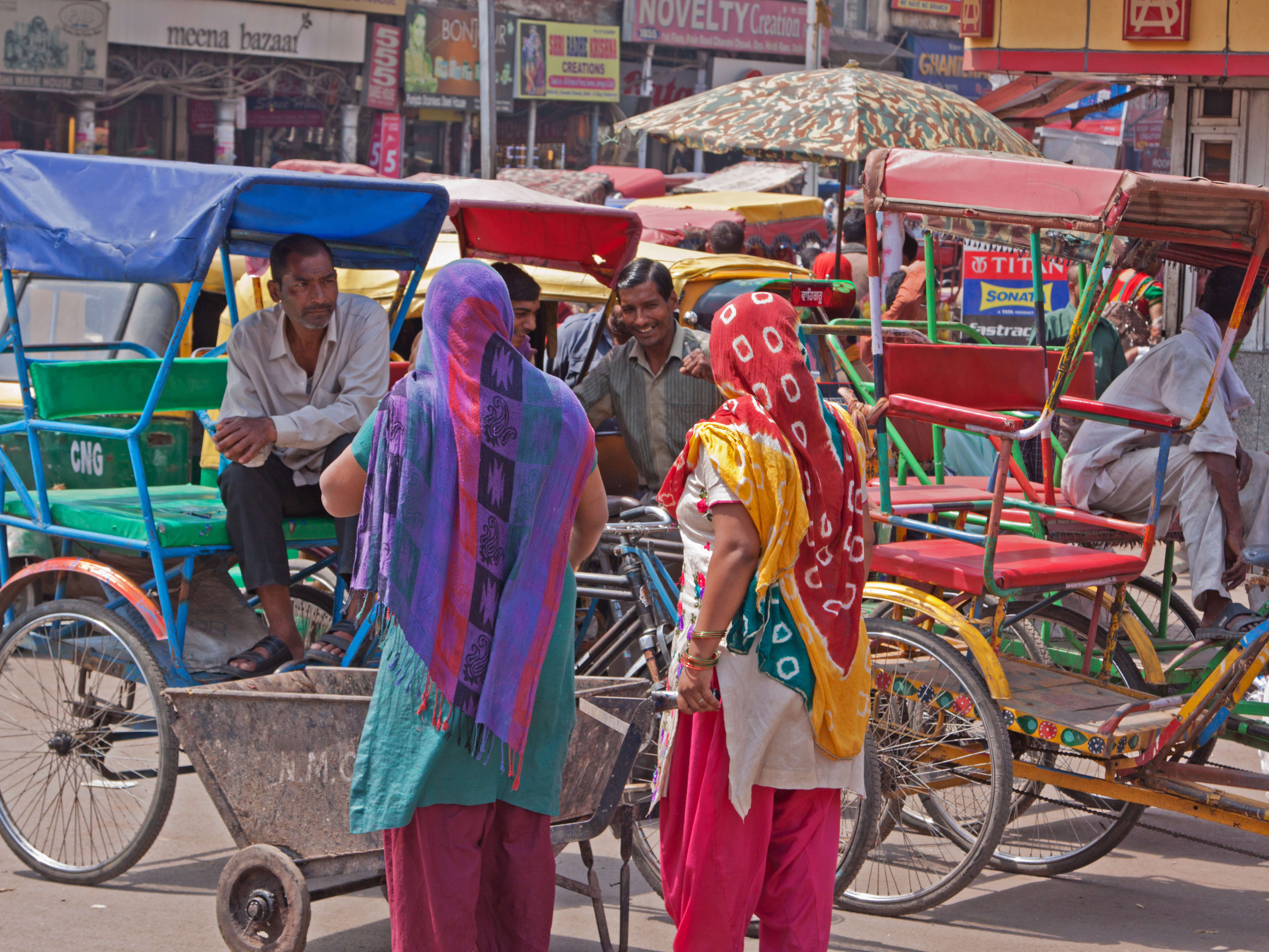Owners of cycle rickshaws chatting to potential customers in the Chandni Chowk area of the old city_