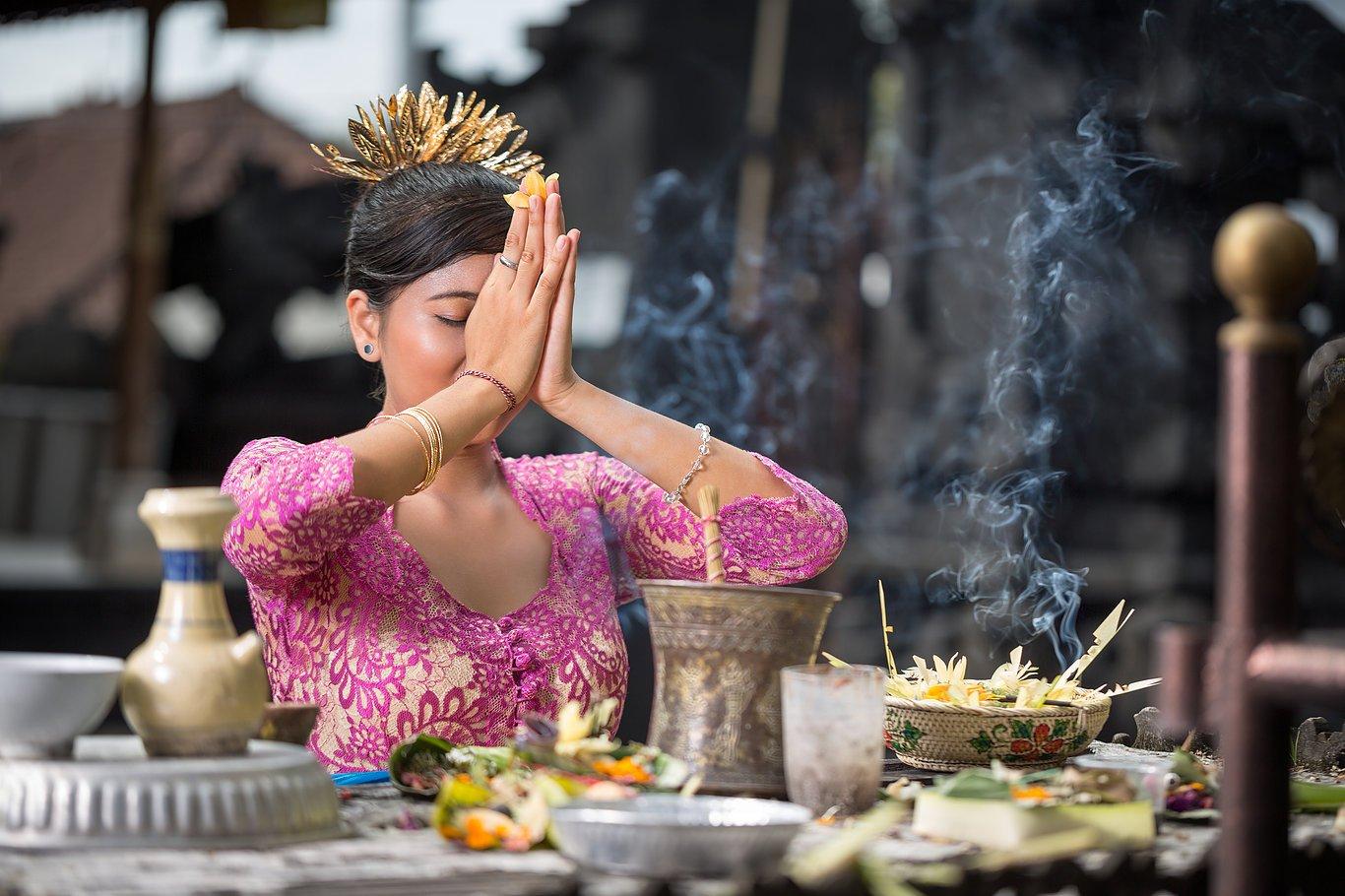 Bali woman praying