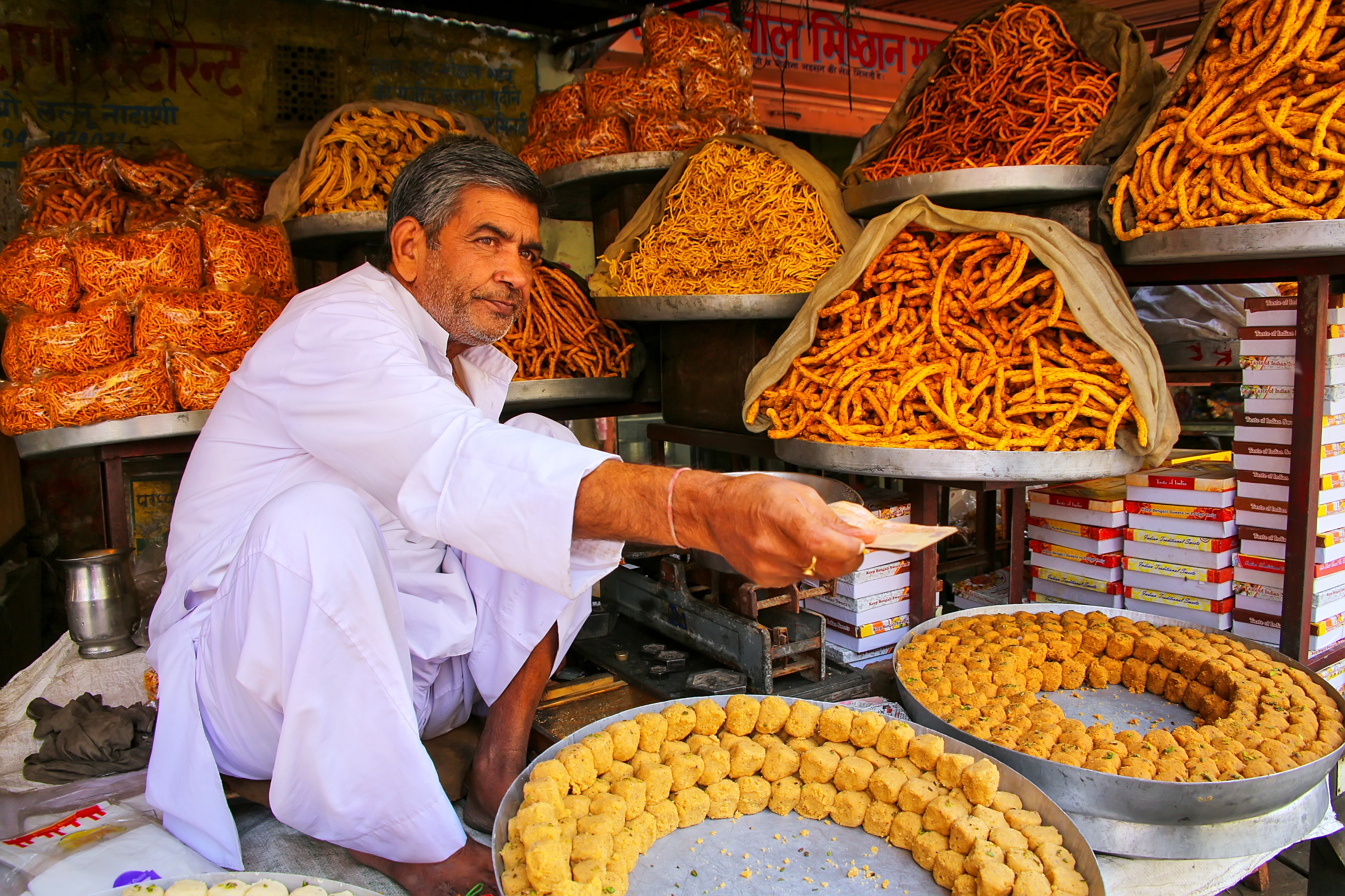 Unidentified man sells snacks near Amber Fort on November 13, 2014 in Amber, India. Amber Fort is th