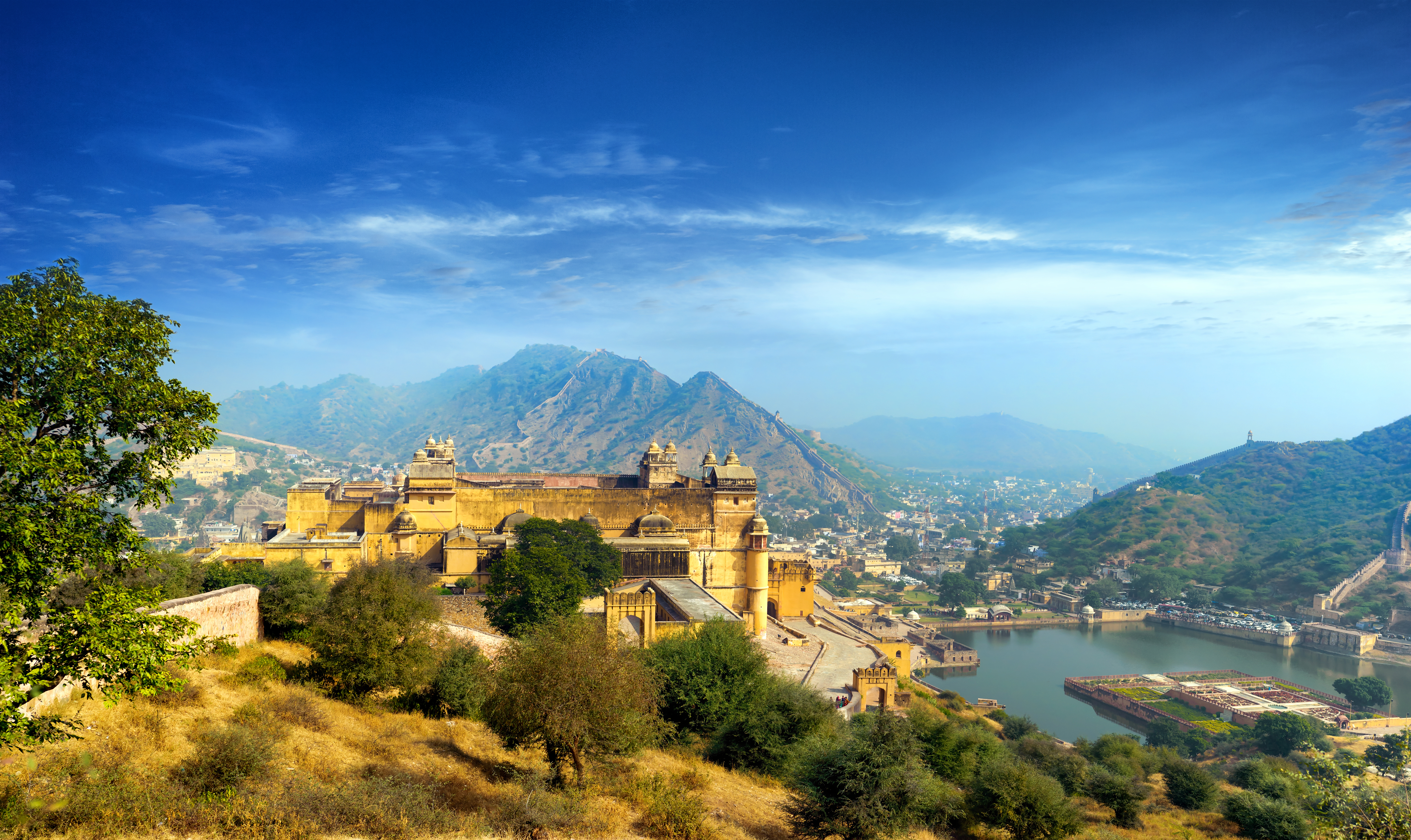 India Jaipur Amber fort in Rajasthan. Ancient indian palace architecture sunset panoramic view_shutt