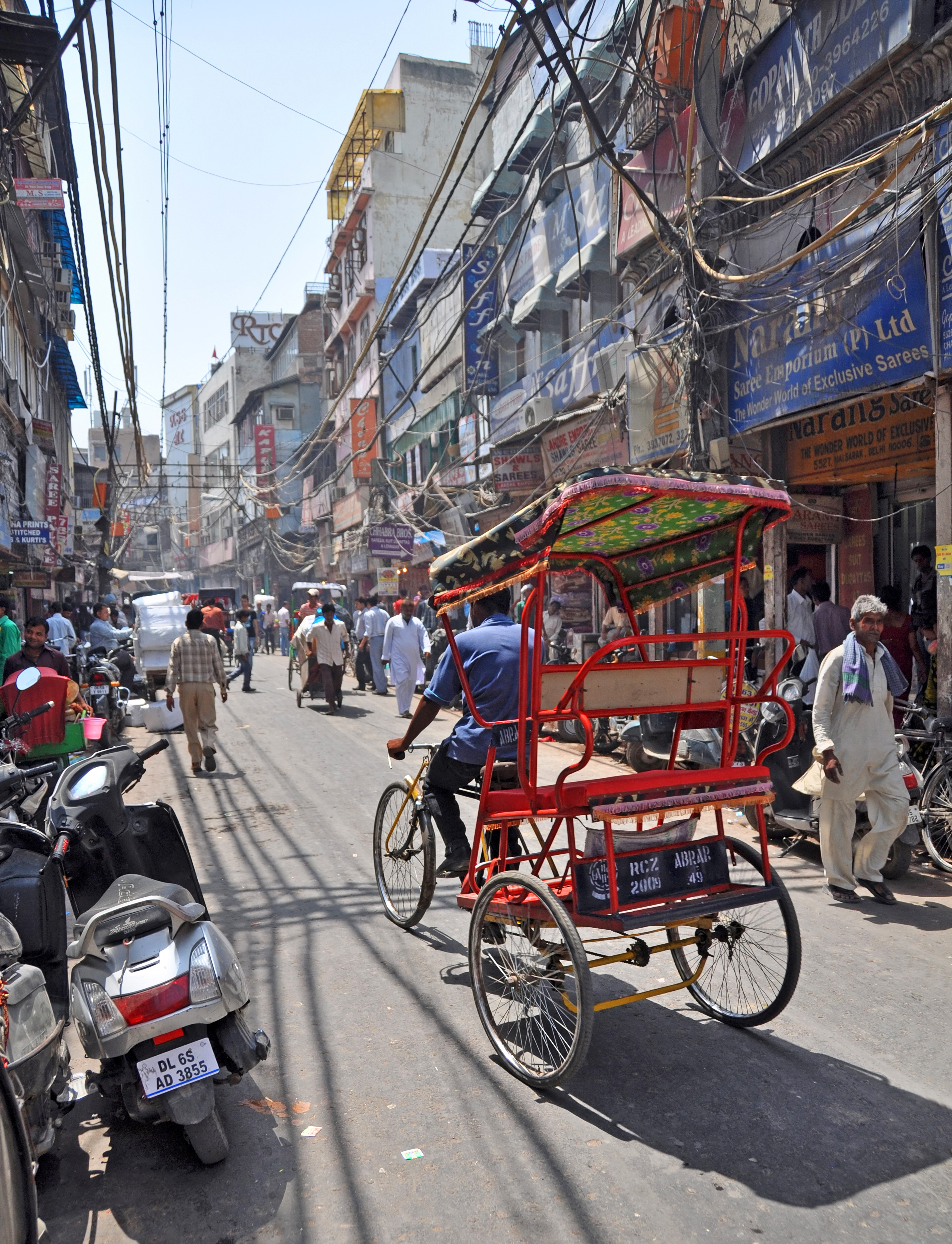 A rickshaw or Cyclo in one of the world's largest markets - Chandri Chowk_shutterstock_174726878