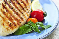 Stock photo of grilled chicken and vegetables