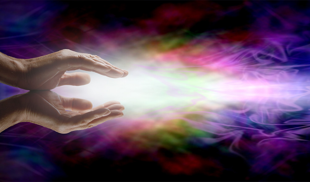 Hands holding light and energy