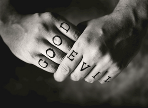 "clasped hands, one labeled ""good,"" the other labeled ""evil"""