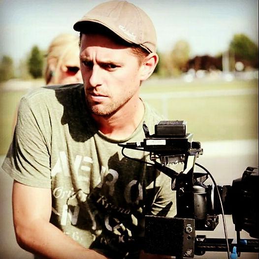 Jason Mils headshot with camera