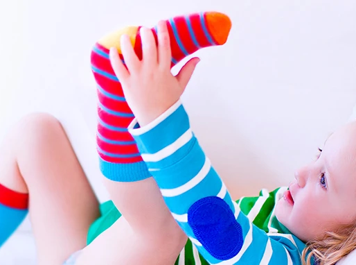 Can a Doll Encourage a Child to Dress Independently?