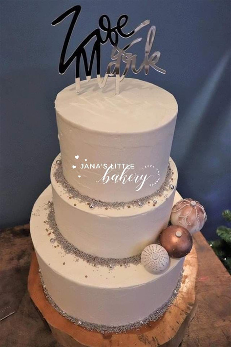 Three Tier Wedding Cake in Different Flavours Covered in Buttercream