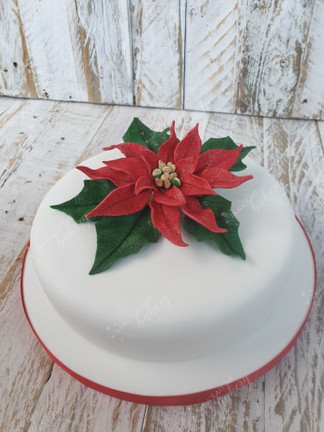 Gluten Free Christmas Cake Decorated with Edible Poinsettia