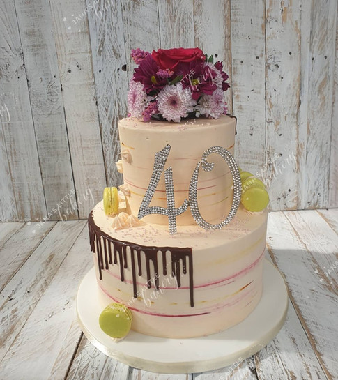 40th Birthday Cake Covered in Buttercream and Decorated with Chocolate Drip, Homemade Macaroons and Fresh Flowers