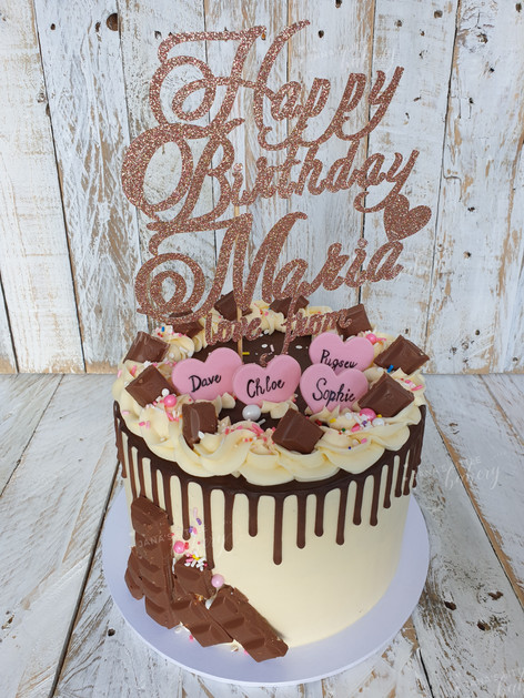 Gluten Free Drip Cake Topped With Favourite Chocolates