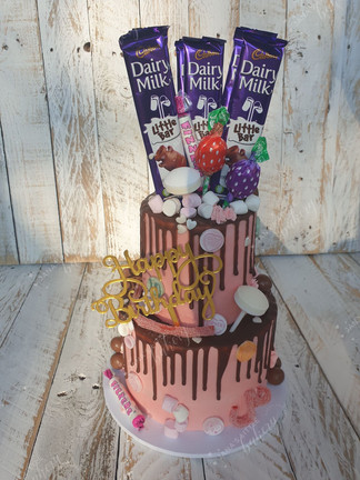 Mini Two Tier cake topped with Sweets and Chocolate