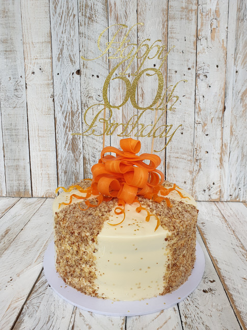 Gluten Free Carrot Cake With Bow Made Out Of Carrots