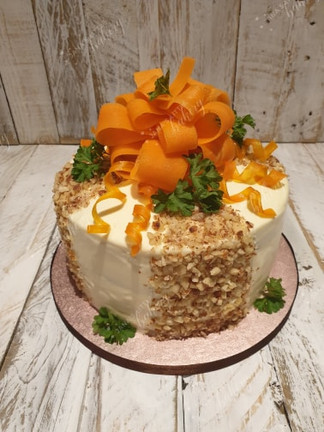 Carrot Cake Decorated with Fresh Carrot Decoration and Almonds