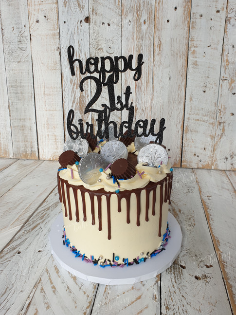 Gluten Free Drip Cake Topped With Chocolates