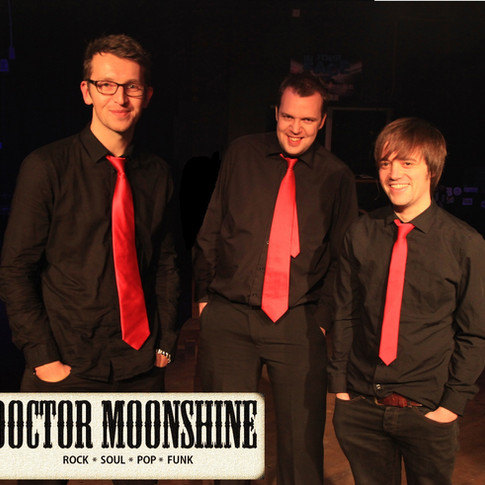 Doc Moonshine Posed w.logo.jpg