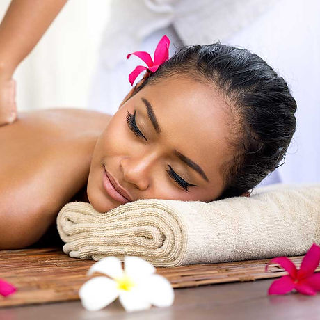 Woman-having-massage-with-flowers.jpg