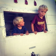 Kids peeking out of the original trailer