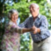 Older couple dancing meals on wheels