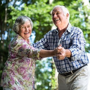 Older couple dancing meals on wheels