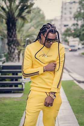 man-with-braided-hair-in-yellow-outfit-3
