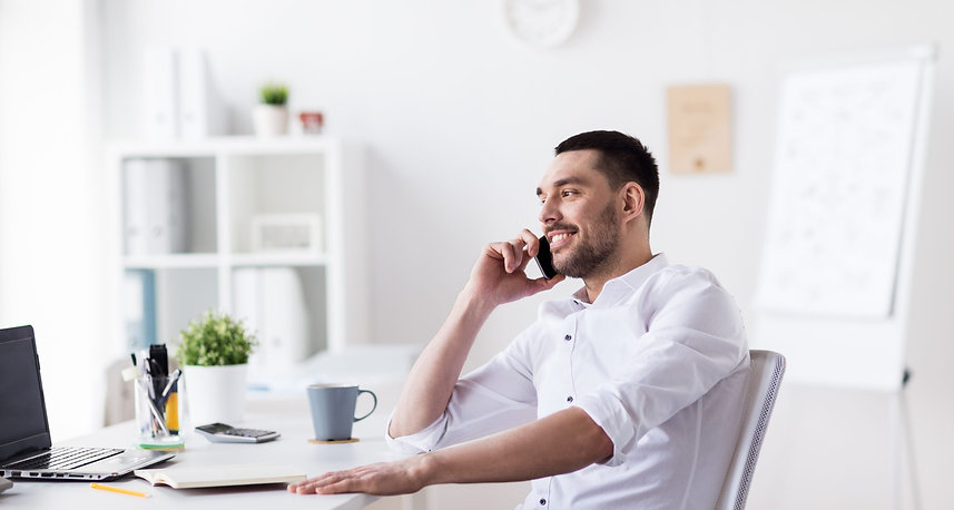businessman-calling-on-smartphone-at-off