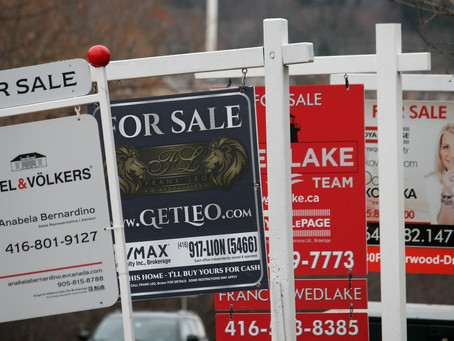 Real estate association revises sales forecast down as prices continue to rise