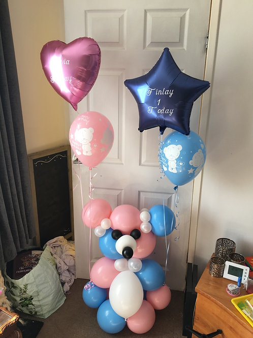 Teddy with helium balloons