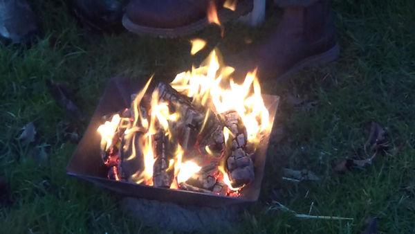 making charcoal in a cone kiln