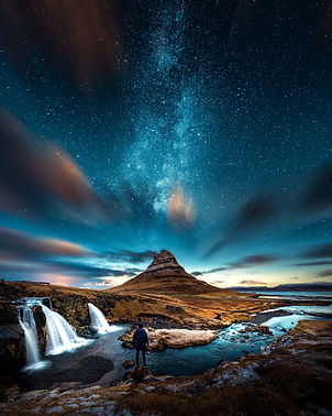 starry sky over serene landscape