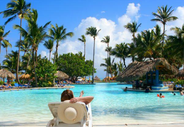 Man on beach chair at caribbean beach resort