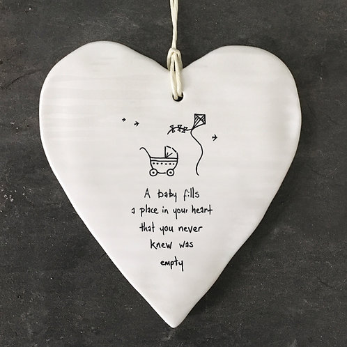 East of India Porcelain Heart. A baby fills a place