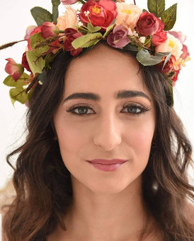 Soft glam makeup with curls and floral wreath