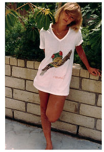 Gita wearing a v-neck tee with Tree Frog