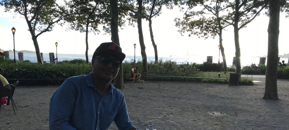 Almost end of the 1st day, chillin in Battery Park sunset, overlooking statue of Liberty .