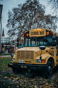 yellow-school-bus-on-road-4543110.jpg