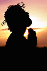 silhouette-image-of-person-praying-16157