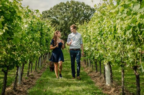 Gusbourne-walking-through-vineyard.jpg