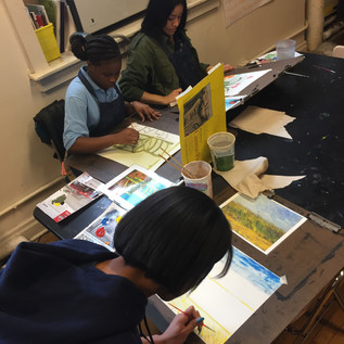 Students working in art