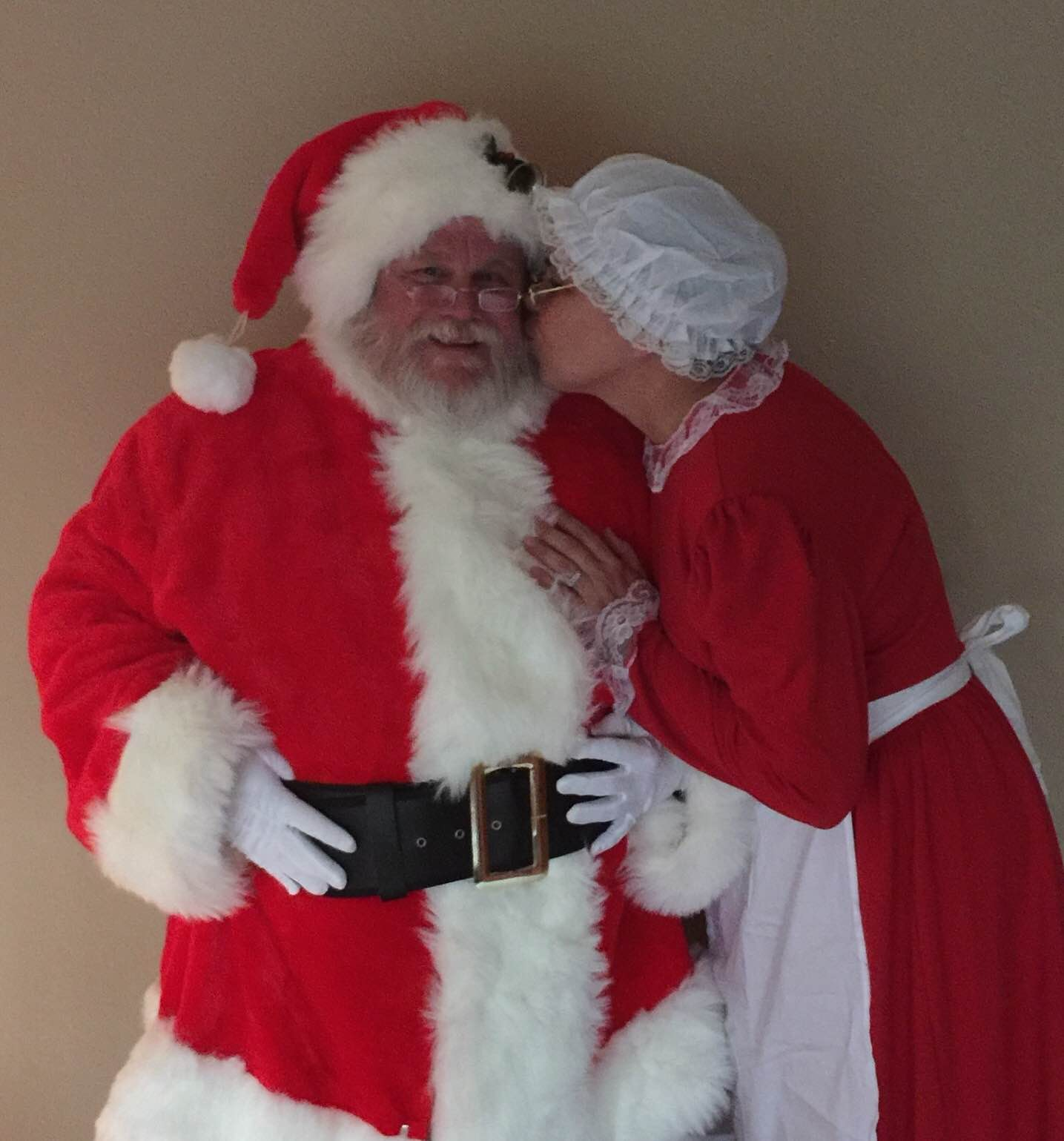 Mike & Joyce Brant - Santa & Mrs Claus Kiss.JPG