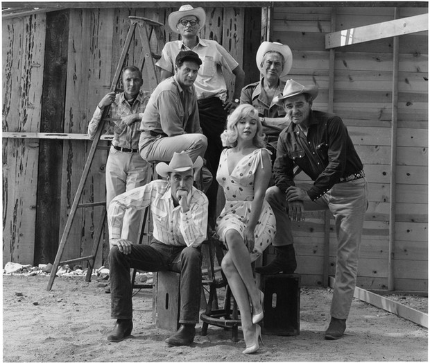 USA. Reno, Nevada. 1960. From left- Frank Taylor, Montgomery Clift, Eli Wallach, Arthur Miller, Marilyn Monroe, John Huston and Clark Gable on the set of 'The Misfits'.