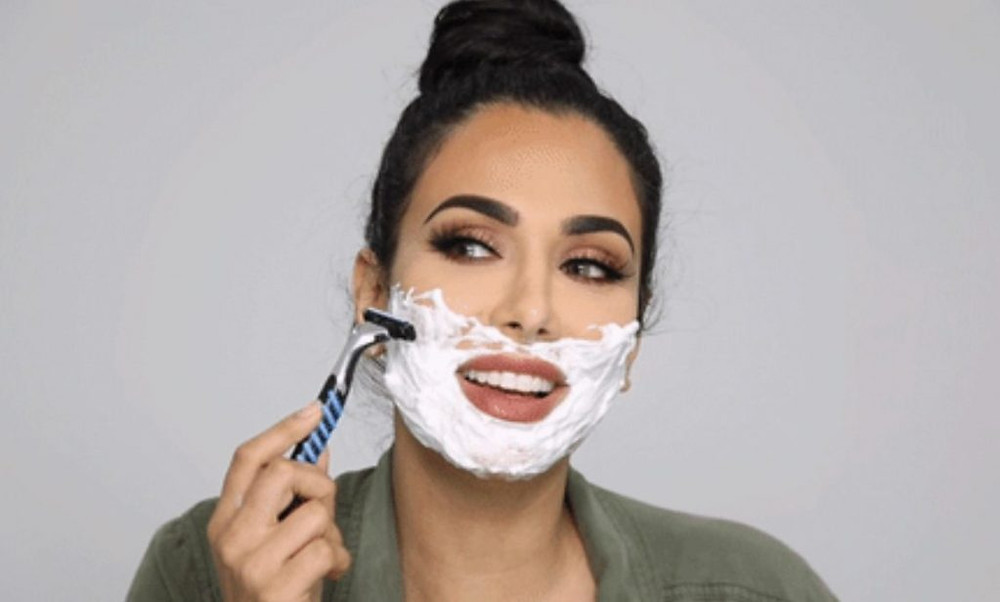 Hudabeauty showing how to face shave