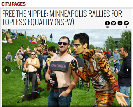 Misha Estrin Free The Nipple News censored tiger shirt, scarf, Minneapolis Free the nipple rally, Topless Equality, City pages, clean Stand up Comedian, comedy, funniest person twin cities contest, protests, NSFW, St paul. Minnesota